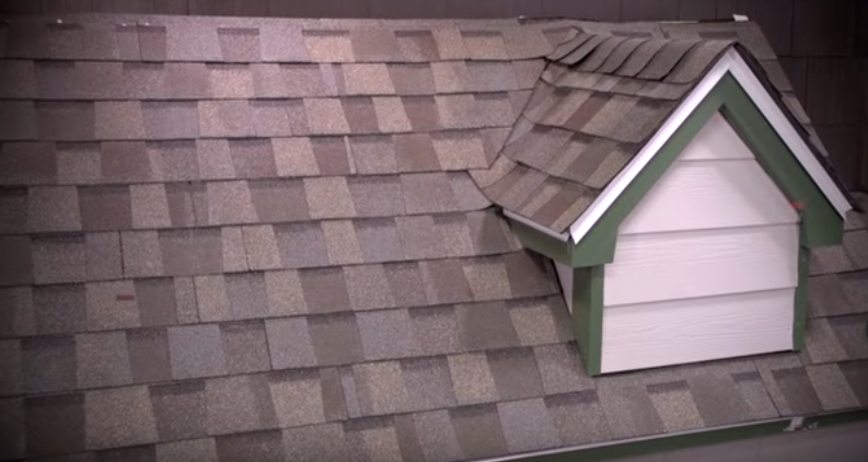 Image of a house with asphalt roof shingles